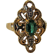 10 Karat Yellow Gold Marquis Emerald Ring With Tiny Diamond Chip Accents in White Gold