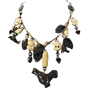 Vintage Deco Festoon With Black Onyx and Carved Lucite Figures