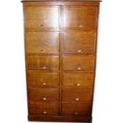 Unusual quartered oak 12 door office file type cabinet