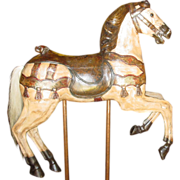 Antique carved wood carousel horse on stand