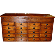 Neat small oak countertop jewelers case-----20 drawers