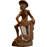 Vintage Hand Carved Wooden Sculpture of a Man with a  Fishing Net