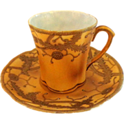 Raised Gold Porcelain Hand Painted Cup and Saucer