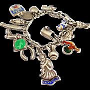 SALE Silver Charm Bracelet Featuring a Rare Enamel Lucky Pixie Charm