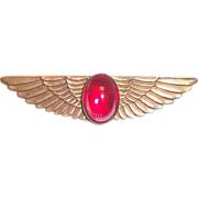 Art Deco Style Brass Wing Shaped Pin with Red Glass Cabochon