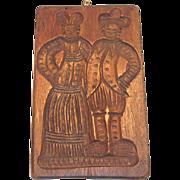Vintage Double Dutch Couple Design on a Wooden Cookie Mold