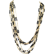 SALE Black and Gold Tone Opera Length 5 Strand Necklace