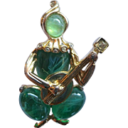 Coro Craft Harlequin Lute Player Brooch with Flawed Emerald Glass Cabochons