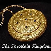 Vintage gilt metal jewel top compact vanity purse floral repousse & sapphire stones