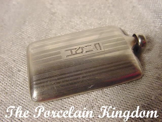 Miniature sterling silver perfume bottle dated 1924