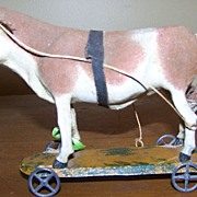 Small Antique Composition Cow on Wheels Pull Toy