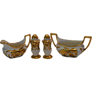 China Condiment Set ~ Creamer / Sugar / Salt & Pepper ~ Hand Painted with Gold Orchids ~ Artist Signed  ~ J. H. Stouffer 1938-1946
