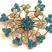 Vintage retro swirl floral brooch pin with teal and white clear rhinestones