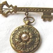 Victorian style locket on key brooch pin