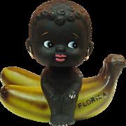 Black Girl on Banana Coin Bank ~ Florida Souvenir ~ Bobblehead