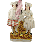 SALE Circa 1860 Staffordshire Figure of Scottish Couple Early
