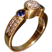 SALE Sleek & Modern 18k Yellow Gold Ring w 65 Point Diamond and two Blue Sapphires