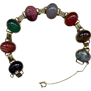 Gold-Filled Link Bracelet with Eight Stone Scarabs