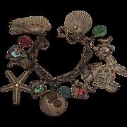 ART Seashell Fish Starfish Art Glass & Rhinestone Charm Bracelet