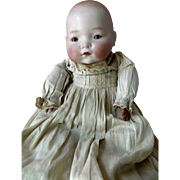 Antique Character Bisque Head Pouty Baby Doll for parts or repair in Elaborate Original Clothi