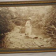 SOLD C. 1900 Framed Real Photo Sepia Print of Young Lady Holding Dress  While Crossing Stream-