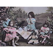 Antique French Hand Tinted Real Photo Postcard of Children's Tea Party with Dolls