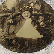 Antique Celluloid Photo Button of Adorable Little Girl in Tree Limb Chair
