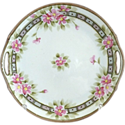 Nippon porcelain cake plate hand painted flowers geometric border
