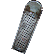 An Early Metal Ware  Tin Nutmeg Spice  Grater with Lid