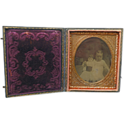 Tintype of Girl With Large Doll Cased Sixth Plate