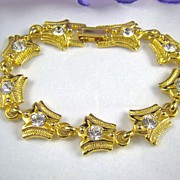 Signed Sparkling Rhinestone and Gold Tone Link Bracelet