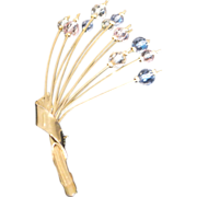 Vintage gold tone metal pin with double layered crystals