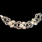 Vintage silver metal and black glass cabochon bracelet