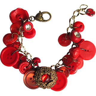 SALE Charm Bracelet of Vintage Buttons in Vivid Shades of Red with Shimmering Filigreed Button