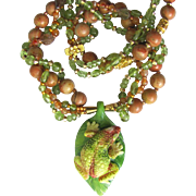 Carved Tree Frog Pendant on Necklace with Intertwined Strands – Peridot – Gold Beads †..