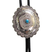 Vintage Navajo Silver Concho Bolo Tie with Stamped Design and Turquoise Cabochon