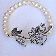 Romantic Contemporary jewelry. Designer bracelet of pearls and sterling silver pendant.