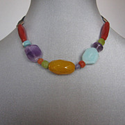 Romantic contemporary jewelry of colorful stones and leather. High end design.