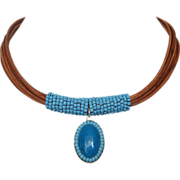 Turquoise pendant, turquoise beads, leather necklace.