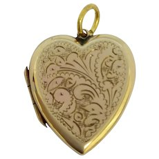 Pretty 1920's 9ct gold back and front locket