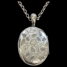 Antique silver floral locket and 20 inch silver chain hallmarked 1881