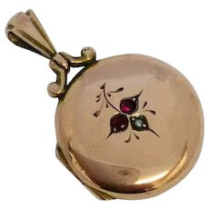 Pretty antique 9ct back and front round locket with garnet and pearl