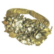 Vintage Multi beaded bracelet decorated with flowers imitation pearls gold leaves and rhinestones