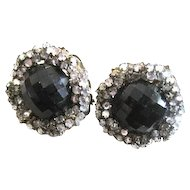 Nice pair of signed Miriam Haskell clip back earrings with black glass center surrounded by rhinestones