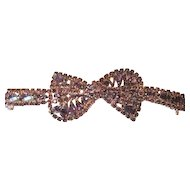Glamorous purple rhinestone bracelet with a bow tie theme