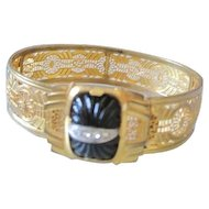 Edwardian gold gilt filagree cuff bracelet with black glass center set with a line of rhinestones