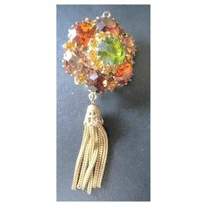 Costume jewelry Pin in Fall colors demantoid green amber and golden with a dangle chain tassel