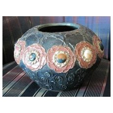 Antique Austrian Ampora bowl with jeweled raised flowers on an iridescent textured background