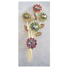 Vintage costume jewelry multi colored floral rhinestone pin in gold tone base metal