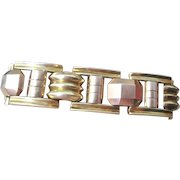 Vintage Retro flexible link Bracelet hallmarked with 14k yellow and rose colored gold